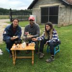 Elic Weitzel (center) takes a break from work to enjoy some baklava with members of the crew near Banja e Pejës on Bajram (Eid al-Fitr). (Photo by Zhaneta Gjyshja)