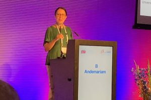 Dr. Biree Andemariam presented her latest phase 2 clinical trial findings in Amsterdam at the European Hematology Association meeting in June 2019. (Photo by Willem Scheele, Imara Inc.)
