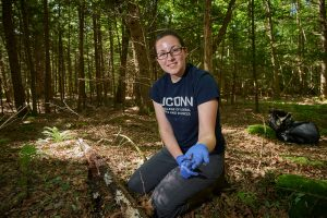 Sarah Baker '20 (CLAS) holds an eastern red-backed salamander found in the Moss Forest Tract in Willington. (Peter Morenus/UConn Photo)