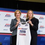 President Susan Herbst, left, and Val Ackerman, Big East commissioner, hold up a jersey marking the announcement of UConn's return to the Big East athletic conference on June 27, 2019. (Peter Morenus/UConn Photo)