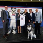 From left, Dan Hurley, men's basketball head coach, left, Jonathan the Husky, President Susan Herbst, Val Ackerman, Big East commissioner, Geno Auriemma, women's basketball head coach, and David Benedict, athletic director, pose for a photo with Jonathan XIV at an event held at Madison Square Garden to announce UConn's return to the Big East athletic conference. (Peter Morenus/UConn Photo)