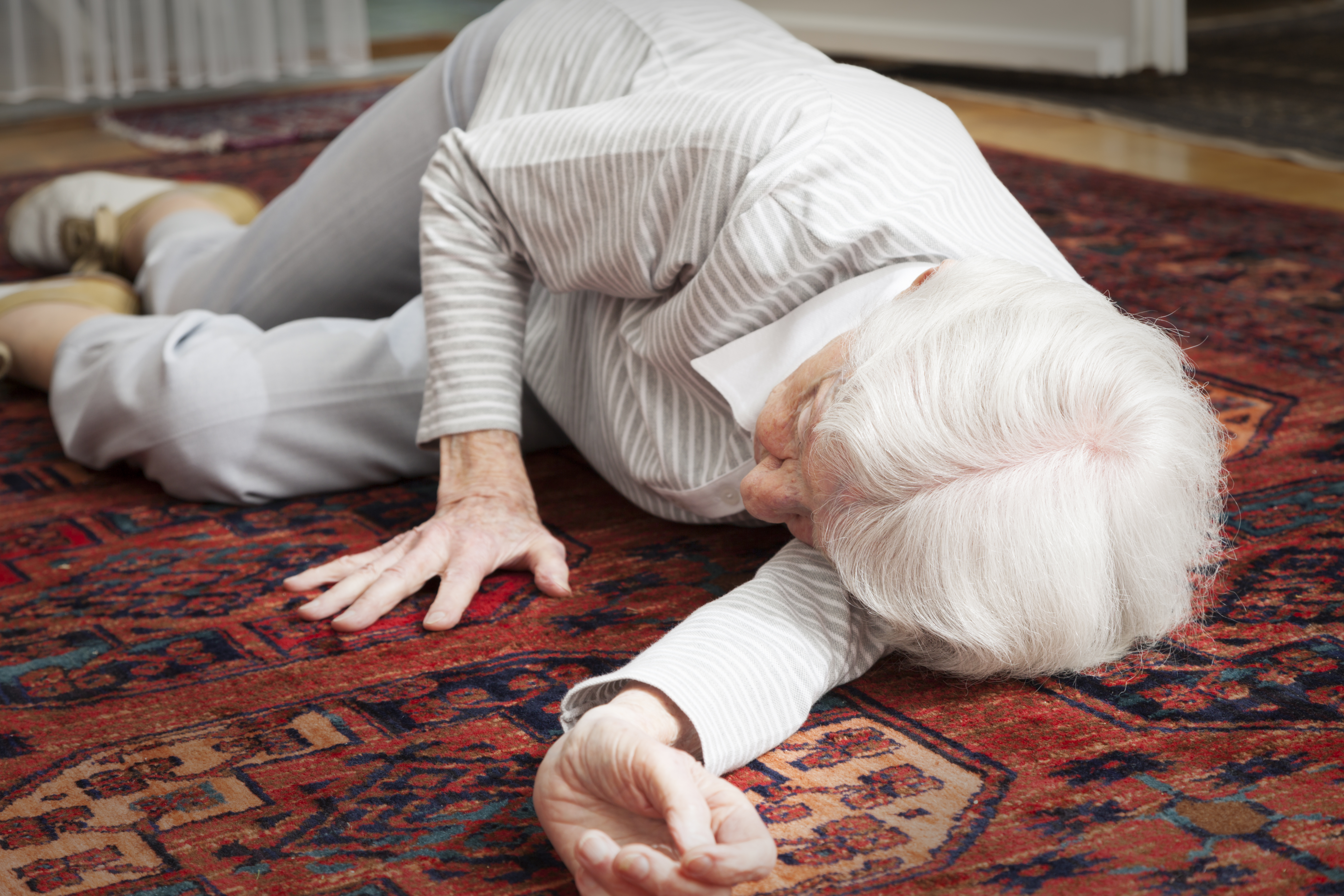An elderly woman lying on the floor after a fall. (Getty Images)
