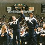 Jamelle Elliott and head coach Geno Auriemma celebrate the 1995 Women's Basketball NCAA Championship, the first in school history, at a welcome home rally in Gampel Pavilion. (Athletic Communications)