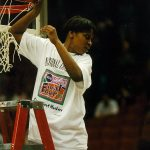 Jamelle Elliott takes her turn cutting down the net following the 1995 NCAA national championship game in Minneapolis. (Athletic Communications)