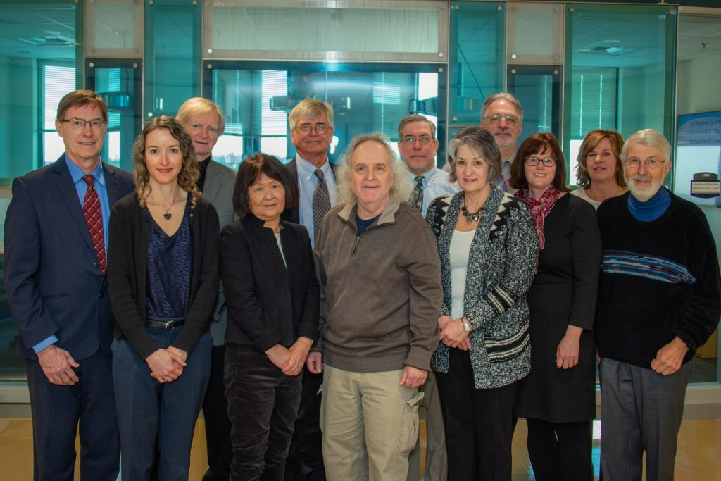 UConn Health Alcohol Research Center scientists gather in March 2019, year 41 of the program. From left: Jonathan Covault, Sheila Alessi, Tom Bavor, Michie Hesselbrock, Victor Hesselbrock, Howard Tennen, Mark Litt, Margie Meadows, Lance Bauer, Carla Rash, Vicki Dupaul-McGloin, Ronald Kadden. (Tina Encarnacion/UConn Health Photo)