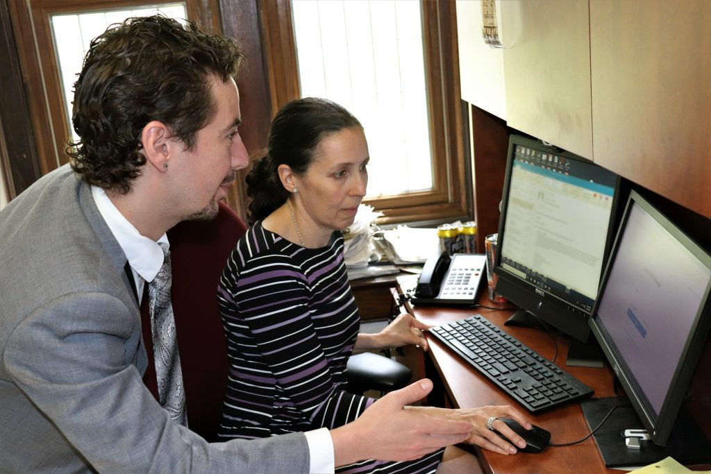 Jonathan Donovan '20 JD assists Jessica Rubin, director of the Animal Law Clinic, in using the new case management system that he and fellow students in a new Technology and Law Practice class devised for the clinic. (Camille Chill/UConn Photo)