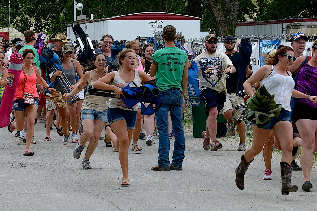 Concert goers stampede through the gate to get front row seating at the annual concert in 2015. (Mark Reinstein/Shutterstock Photo)