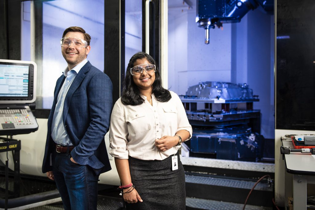 MBA student Don Pendagast (left) and MSBAPM student Chitra Reddy (right), were on a six person team dedicated to helping PCX Aerospace improve their critical data-collection systems. (Nathan Oldham / UConn School of Business)