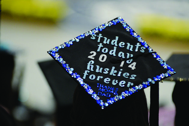 A student graduating in 2014 wears a cap with the legend, 'Students Today, Huskies Forever.' (Elizabeth Caron/UConn File Photo)