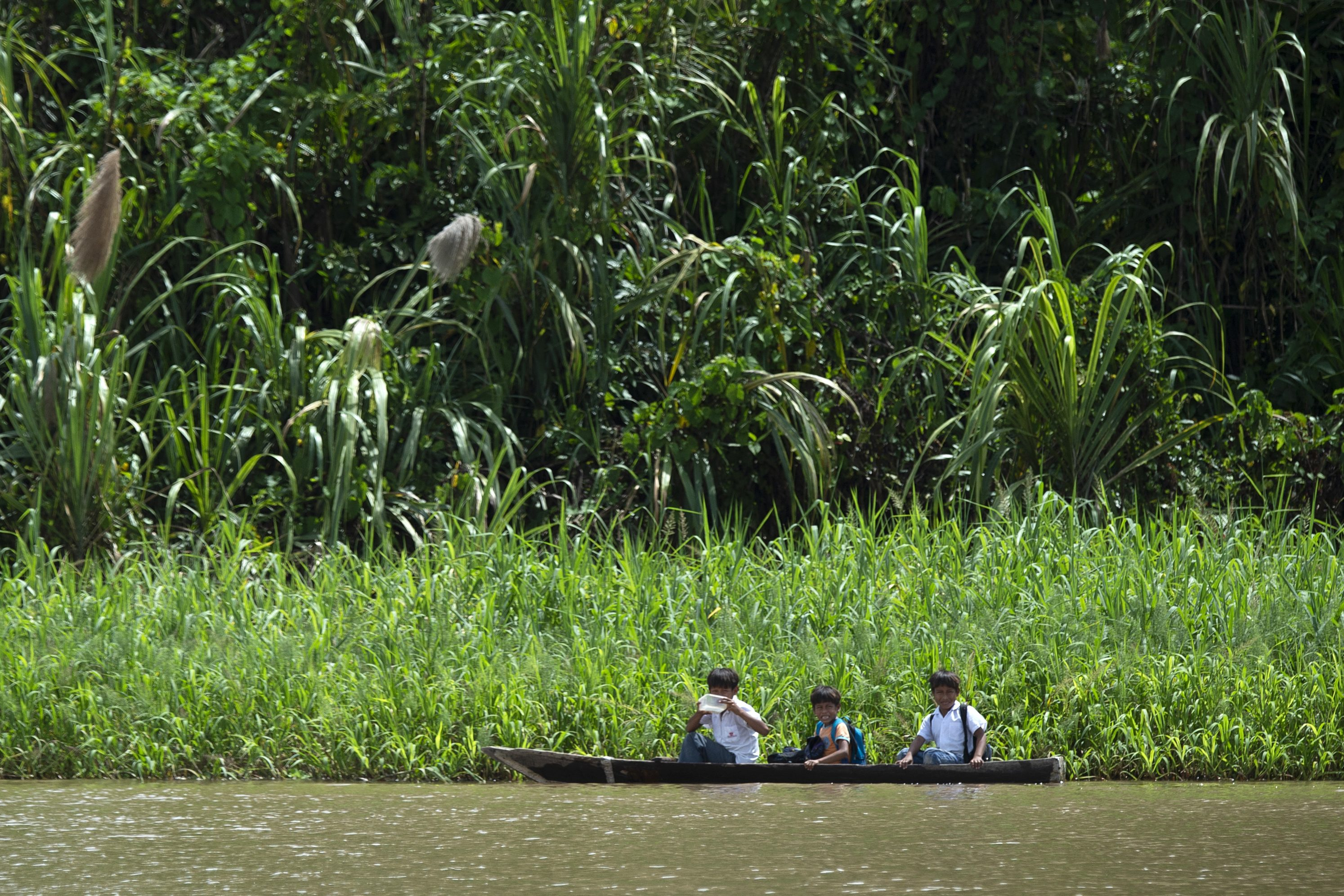 Children go to school by canoe on the Maranon River, a main tributary of the Amazon River, in the Pacaya Samiria National Reserve in May 2019. (Cris Bouroncle/AFP/Getty Images)