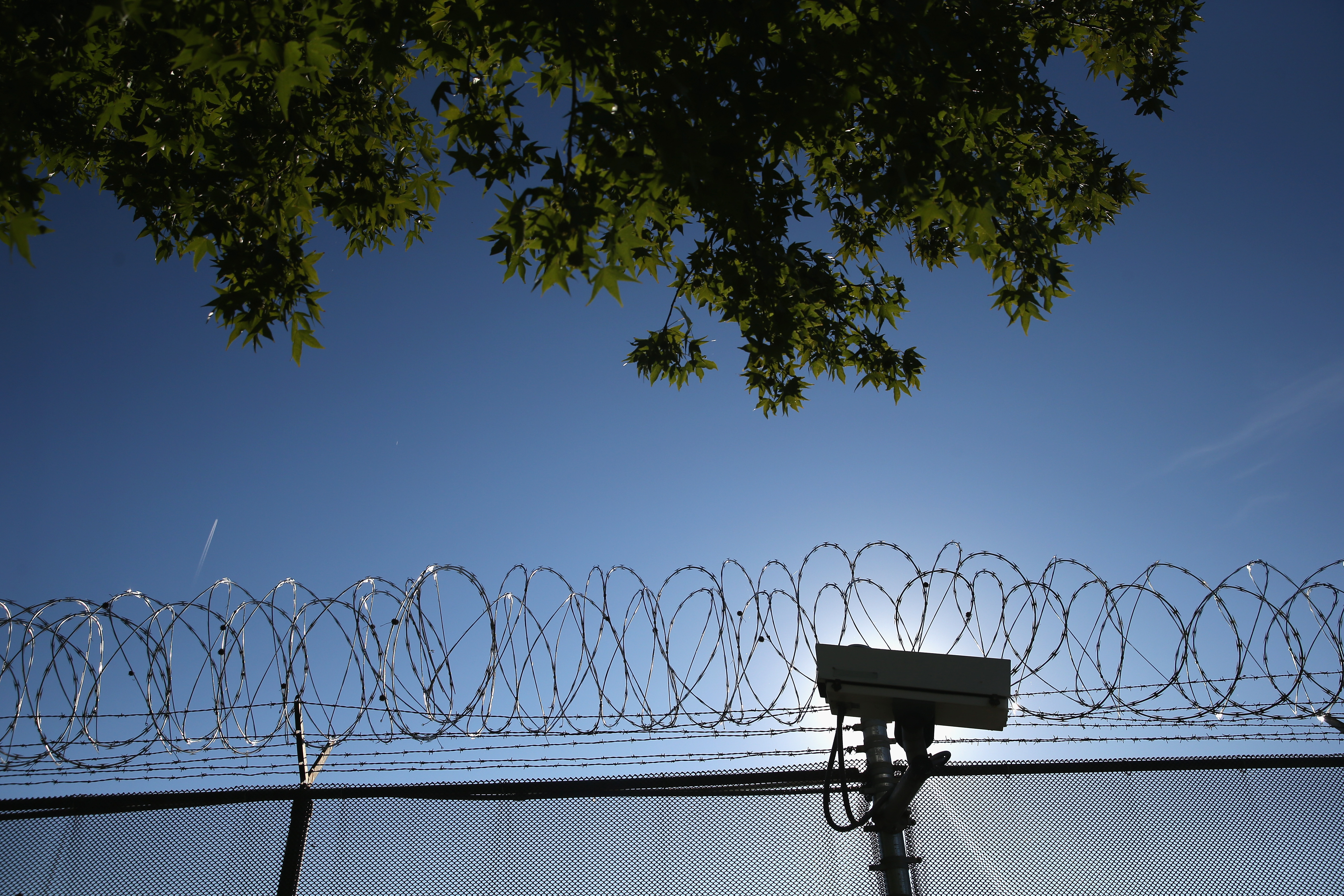 A fence topped with razor wire outside York County Detention Center in York, Pa.
