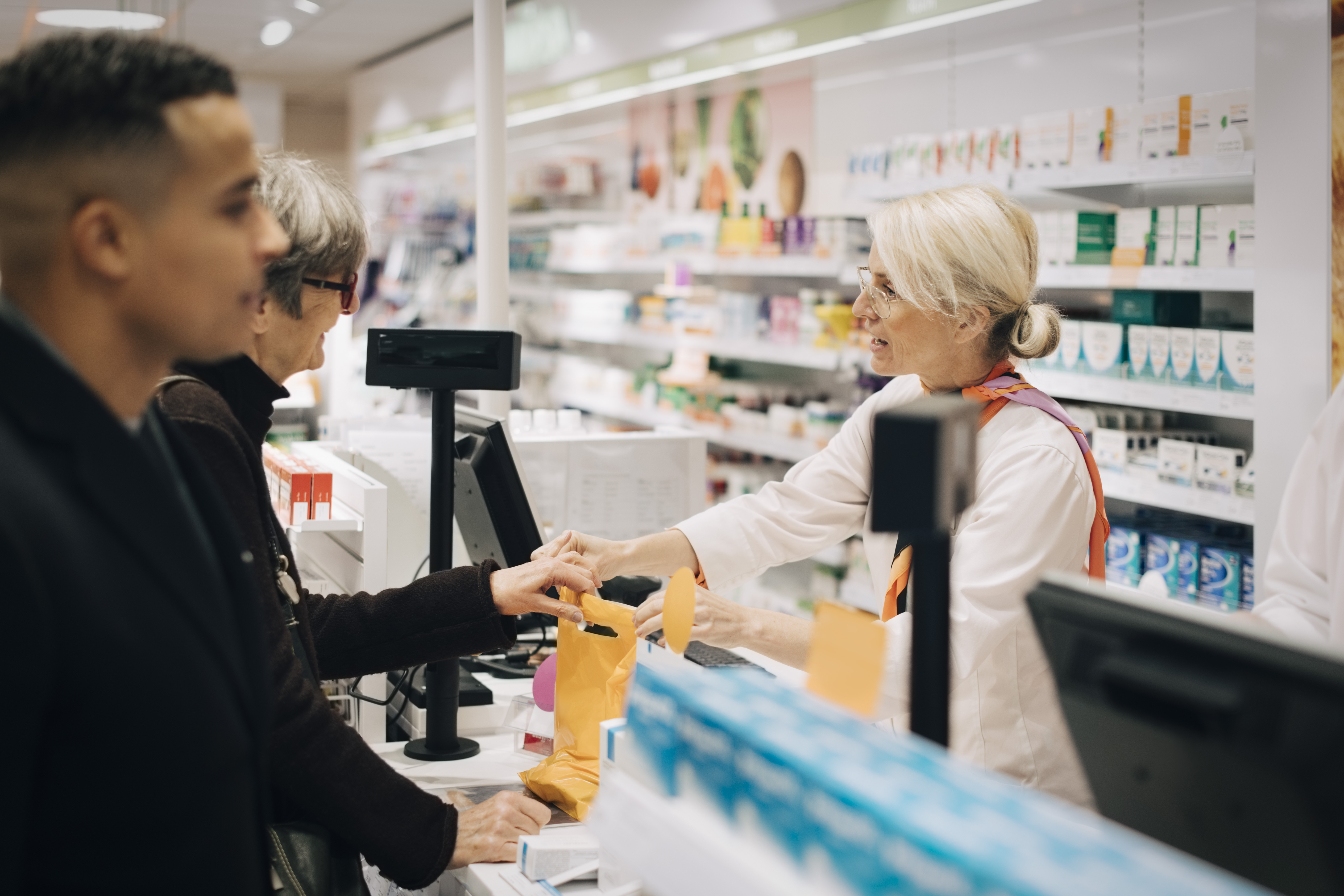 Pharmacists and customers. (Getty Images)