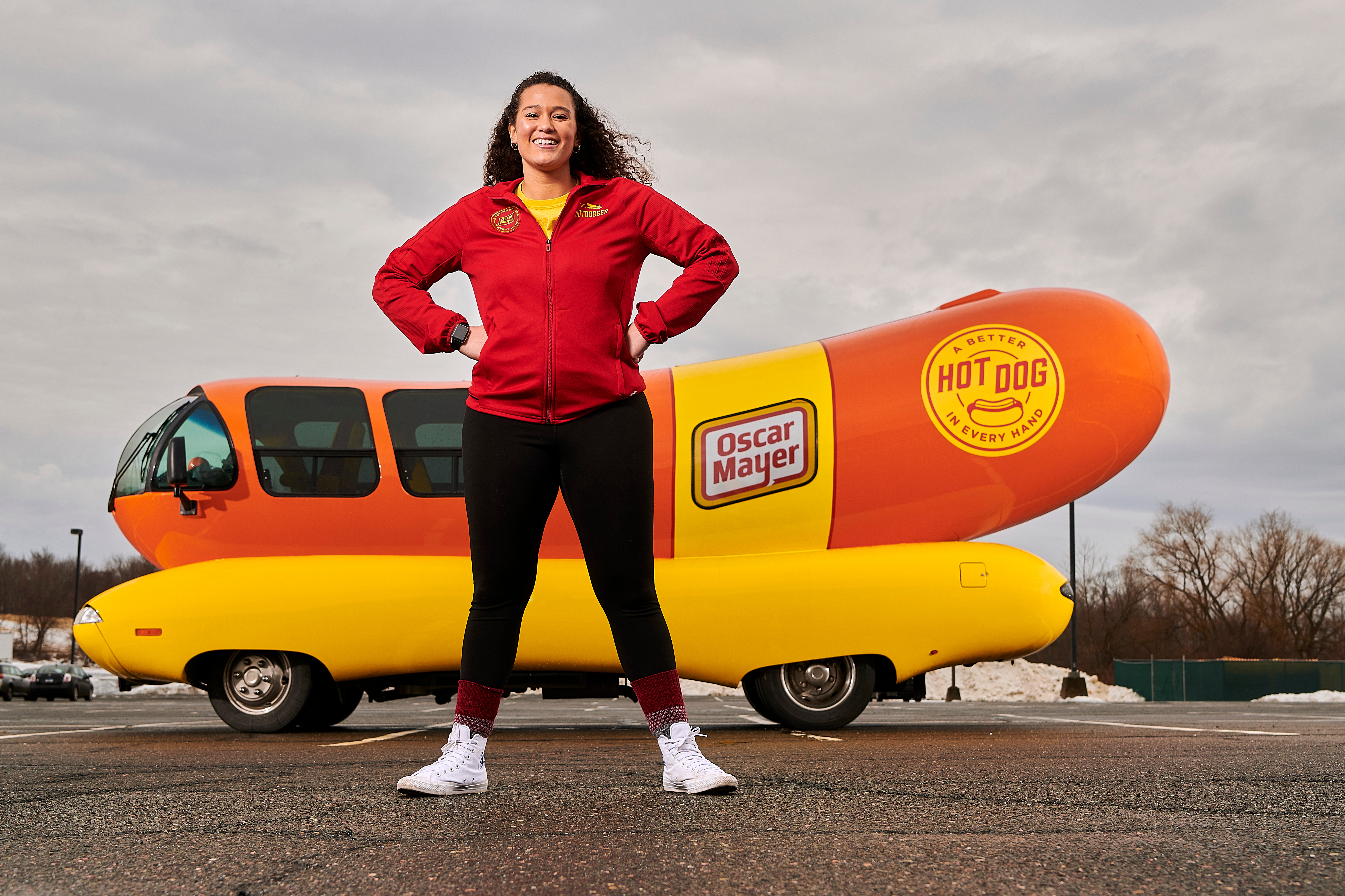 Gabriella Medvik '17 (SFA) poses with the Oscar Mayer Wienermobile in campus. (Peter Morenus/UConn Photo)