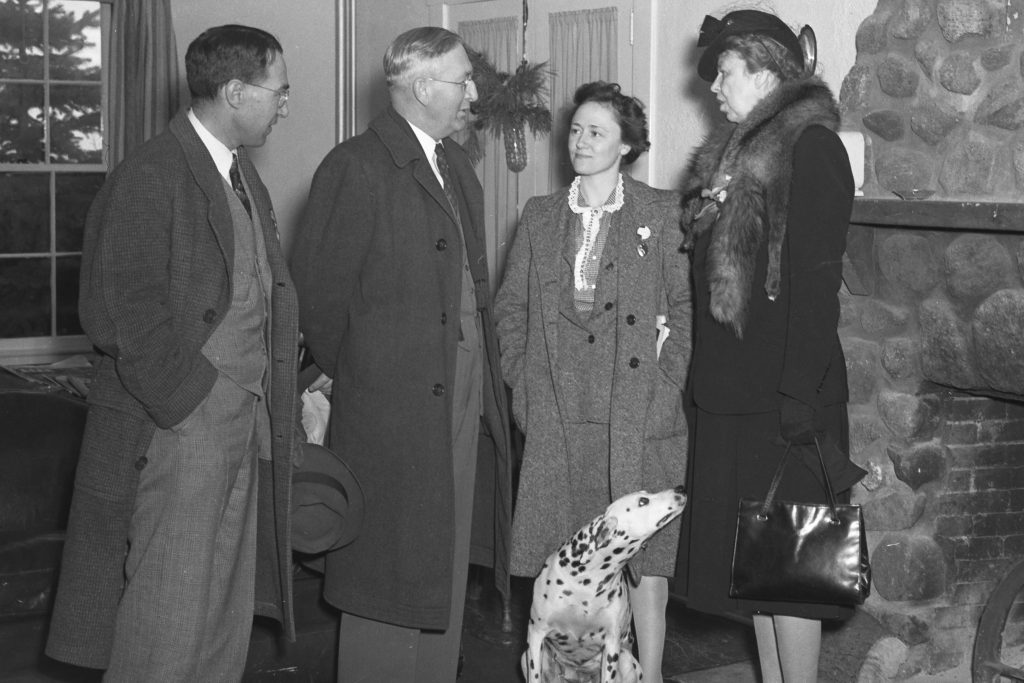 In this 1943 photo with First Lady Eleanor Roosevelt (right) are, from left, farm management professor Paul Putnam and agriculture dean Edwin G. Woodward. The woman standing next to the First Lady is not identified. (University Library Archives & Special Collections)