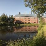 A view of the Chemistry Building from the other end of Swan Lake. (Sean Flynn/UConn Photo)