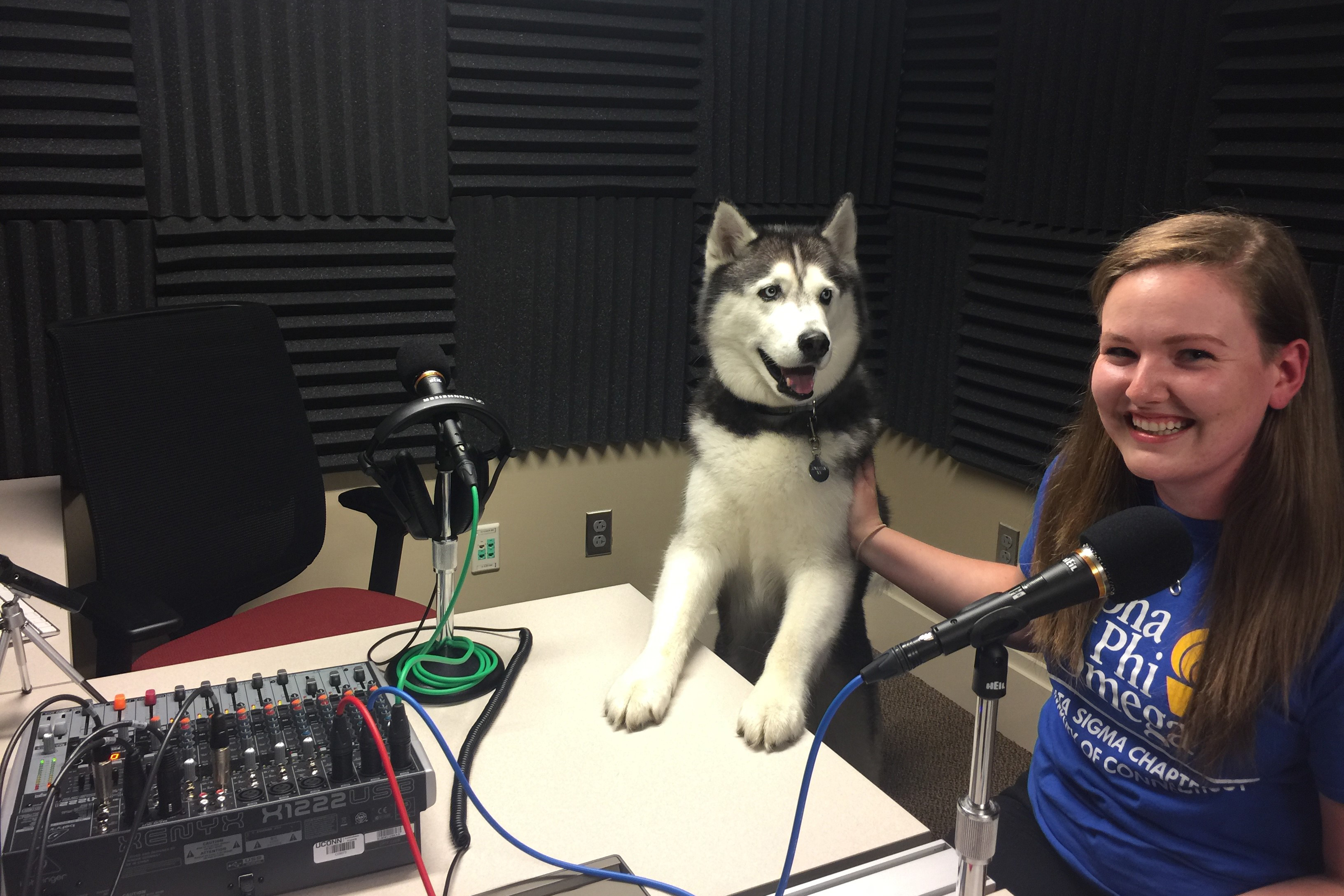 "Jonathan XIV at the UConn 360 studios, with one of his handlers, APO Husky Committee co-chair Marie-Claire ""M.C."" Meadows '20 (CLAS). (UConn Photo)"