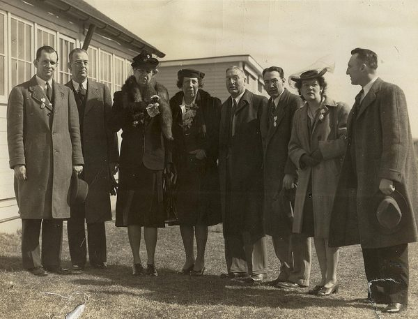 Members of the UConn administration with First Lady Eleanor Roosevelt in 1943. To the left of Roosevelt is President Albert Jorgensen. Second right from the First Lady is Edwin G. Woodward, dean of the College of Agriculture, and to his right is farm management professor Paul Putnam. The person standing at far right is assistant dean Wilfred B. Young. The other individuals are not identified. (University Library Archives & Special Collections)