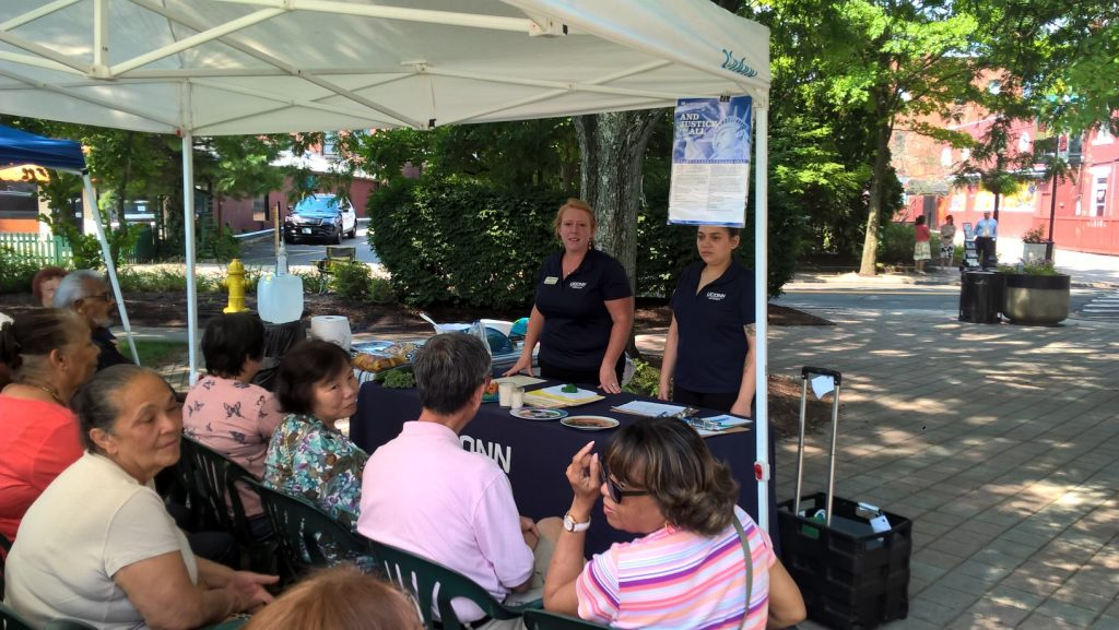 UConn Extension members Heather Peracchio, left, and Julianne Restrepo Marin give a nutrition class in English and Spanish at the Danbury Farmers' Market. (Sara Putnam/UConn Photo)