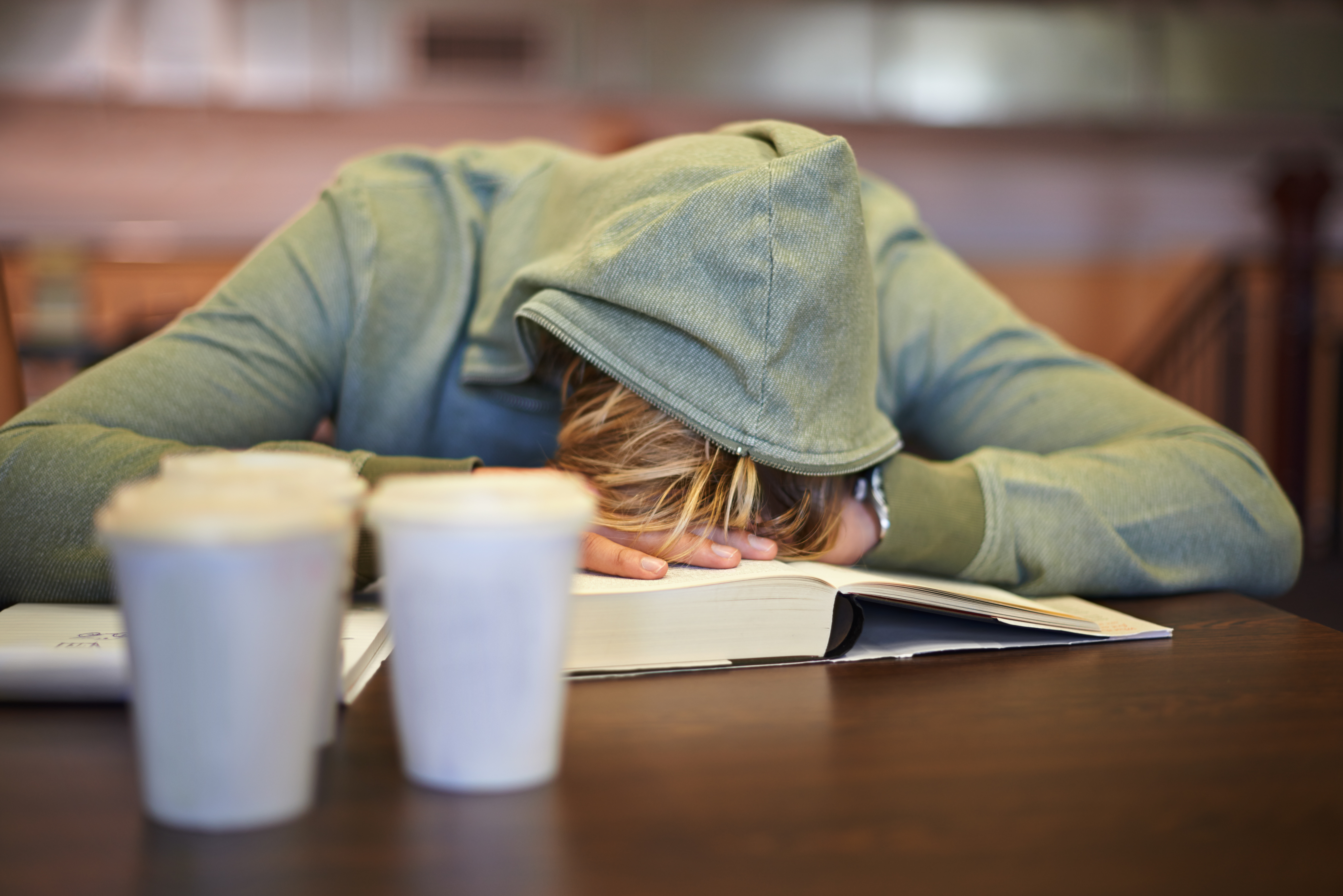 A young student asleep at school. (Getty Images)
