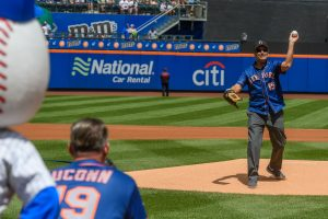 President Tom Katsouleas, right, throws the ceremonial first pitch to Scott Roberts, UConn foundation president, at Citi Field in Queens during a New York Mets baseball game on Aug. 11, 2019. (Peter Morenus/UConn Photo)