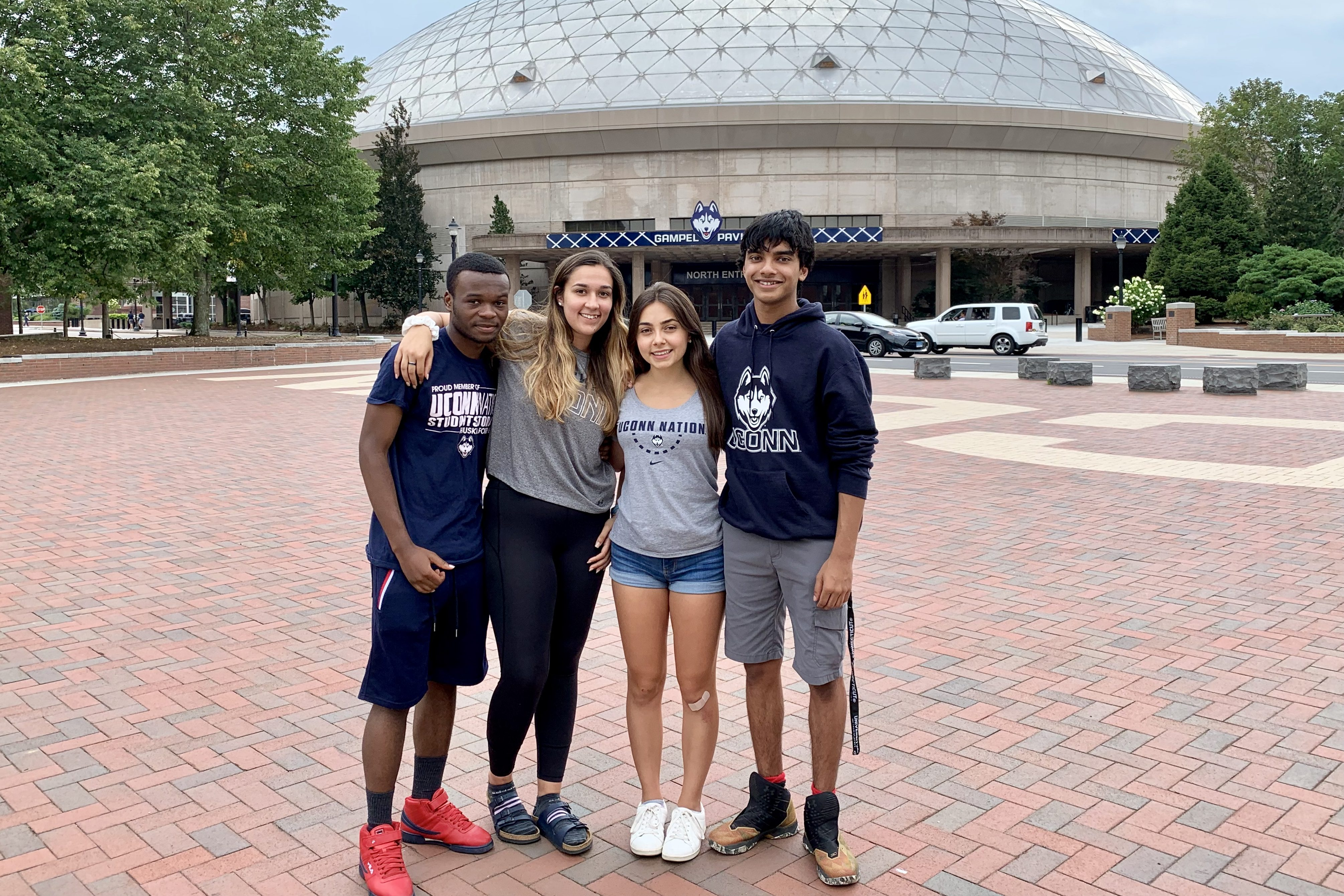 UConn's Class of 2023 includes more than 5,400 incoming freshmen, about 77% of whom live in Connecticut, including (L to R): Heri Mulungula of New Haven, Julia Lawler of Ridgefield, Sarah Ibrahim of Coventry, and Areez Rahim of Avon. (Stephanie Reitz/UConn Photo)