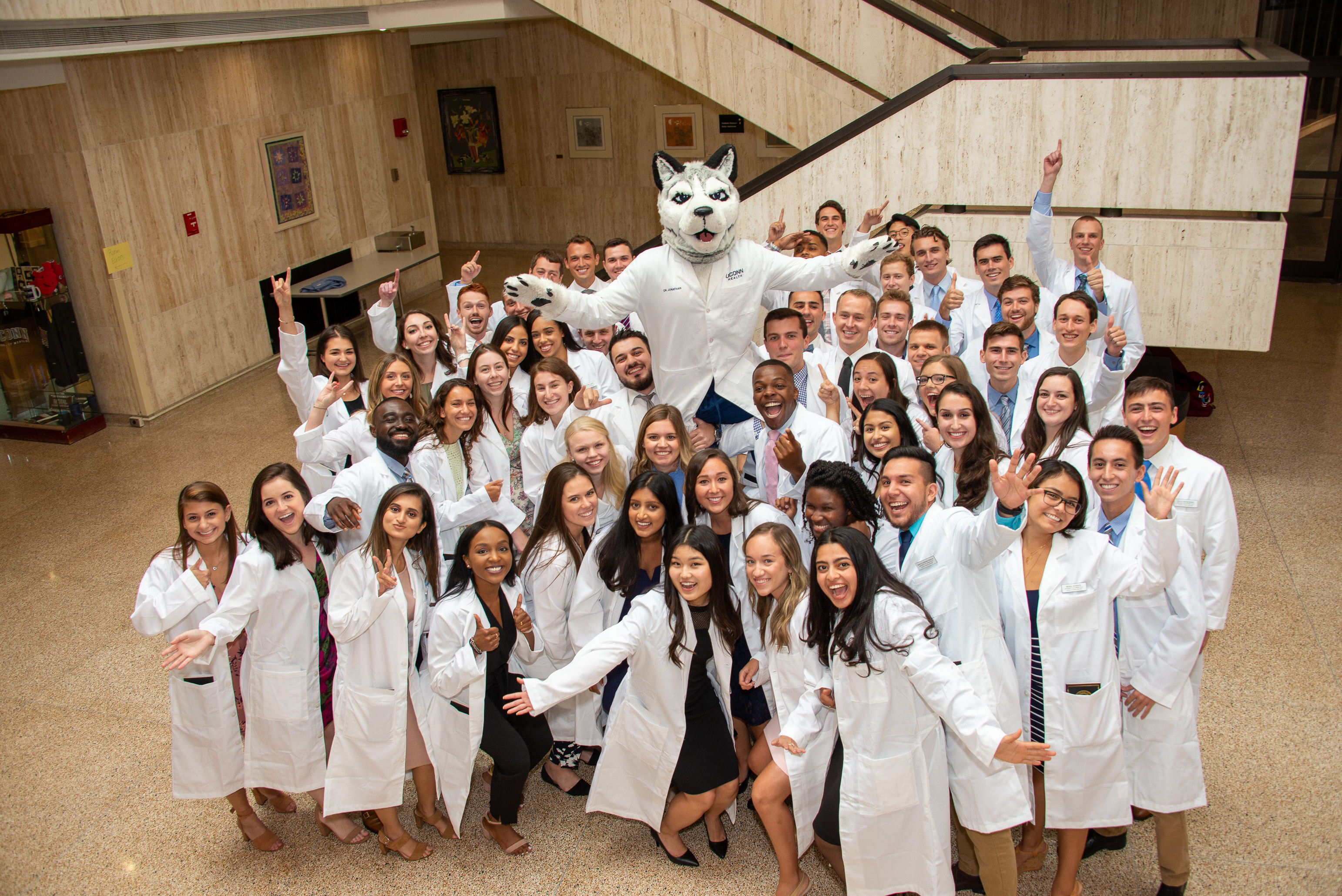 Fifty-four students in the UConn School of Dental Medicine Class of 2023 (pictured) received their white coats on Aug. 23, along with UConn School of Medicine's 110 new medical students. (Tina Encarnacion/UConn Health photo)