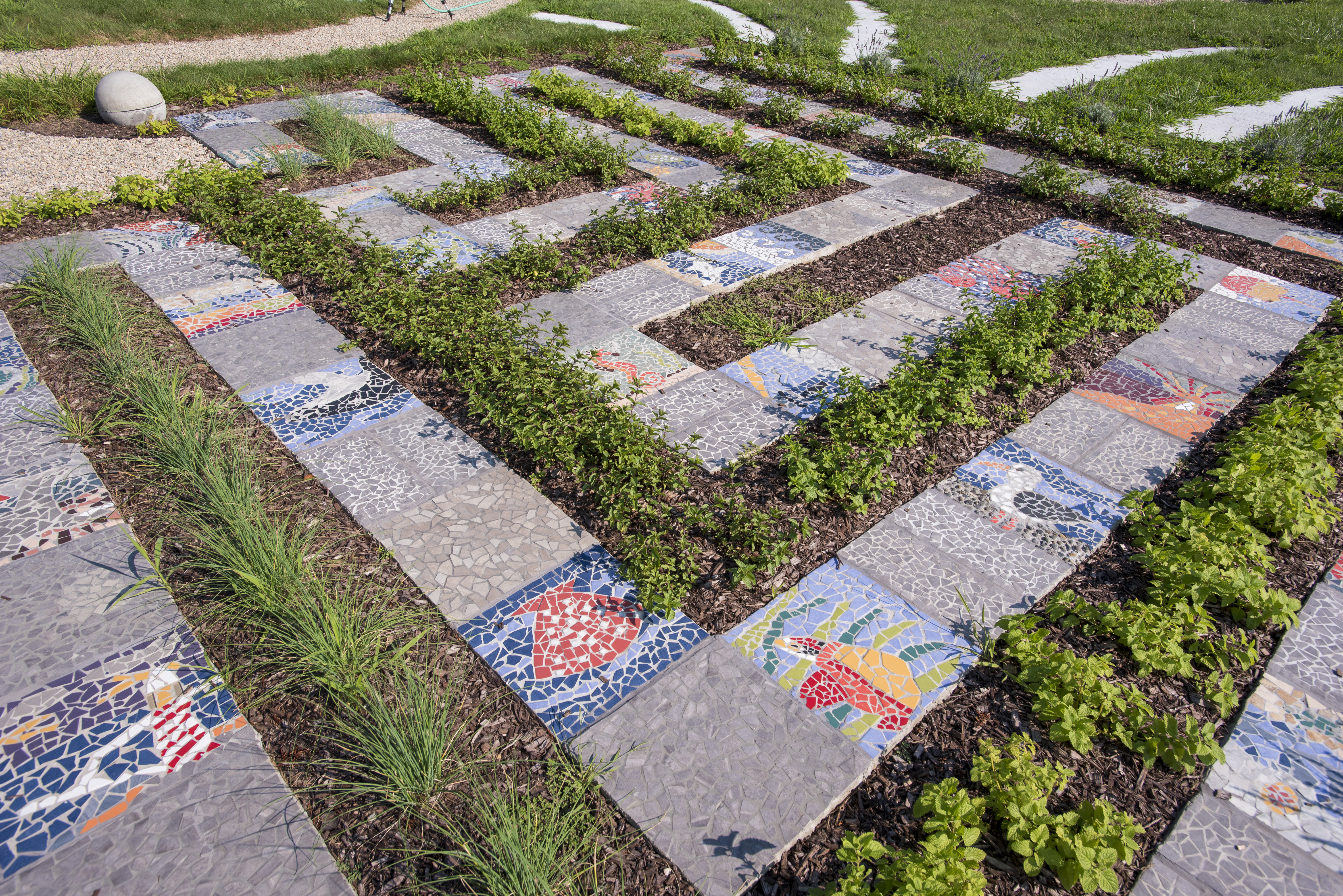 A maze of colored mosaic tiles at UConn Avery Point, part of the new cognitive garden at the campus