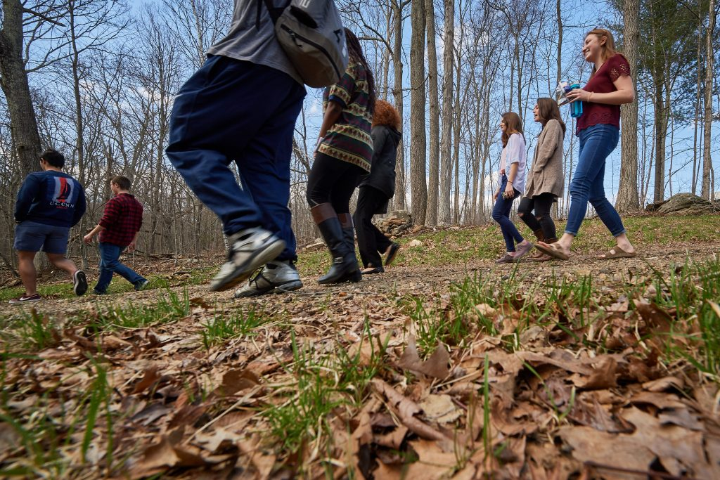 A group hike following the reopening of the Hillside Environmental Education Park trail nearthe Innovation Partnership Building on April 26, 2018. UConn hosts a number of living laboratories such as the UConn Forest and the Hillside Environmental Education Park (HEEP). Once a landfill, HEEP has since been extensively remediated and now hosts a rejuvenating ecosystem and wildlife habitat. (Peter Morenus/UConn Photo)