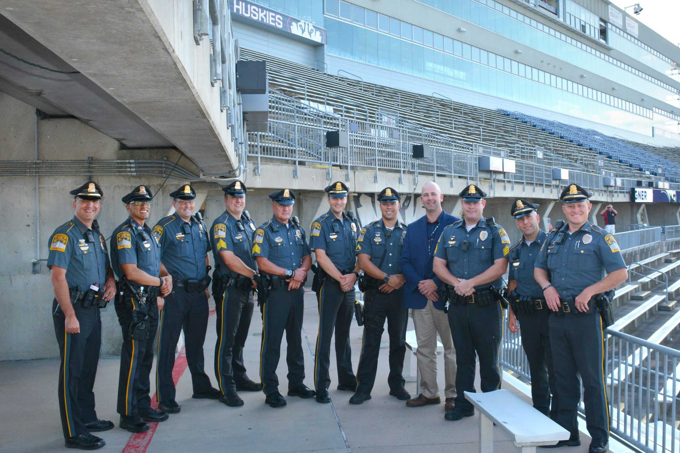 From left to right, Chief Hans D. Rhynhart '93 and '18; Officer Alex Rodriguez '14; Sgt. Peter Harris '03; Sgt. Justin Cheney '07; Sgt. Marc Hanna '88; Lt. Matthew C. Zadrowski '07; Officer Tyler Hopson '13; Lt. Darren Cook '94; Sgt. Mark Bouthillier '07; Deputy Chief Andrew Fournier '95 '01; Lt. Justin Gilbert '06. UConn grads not pictured: Officer Robin Kiddy; Sgt. Zachary Ladyga; Officer Joseph Conetta. (Submitted Photo)