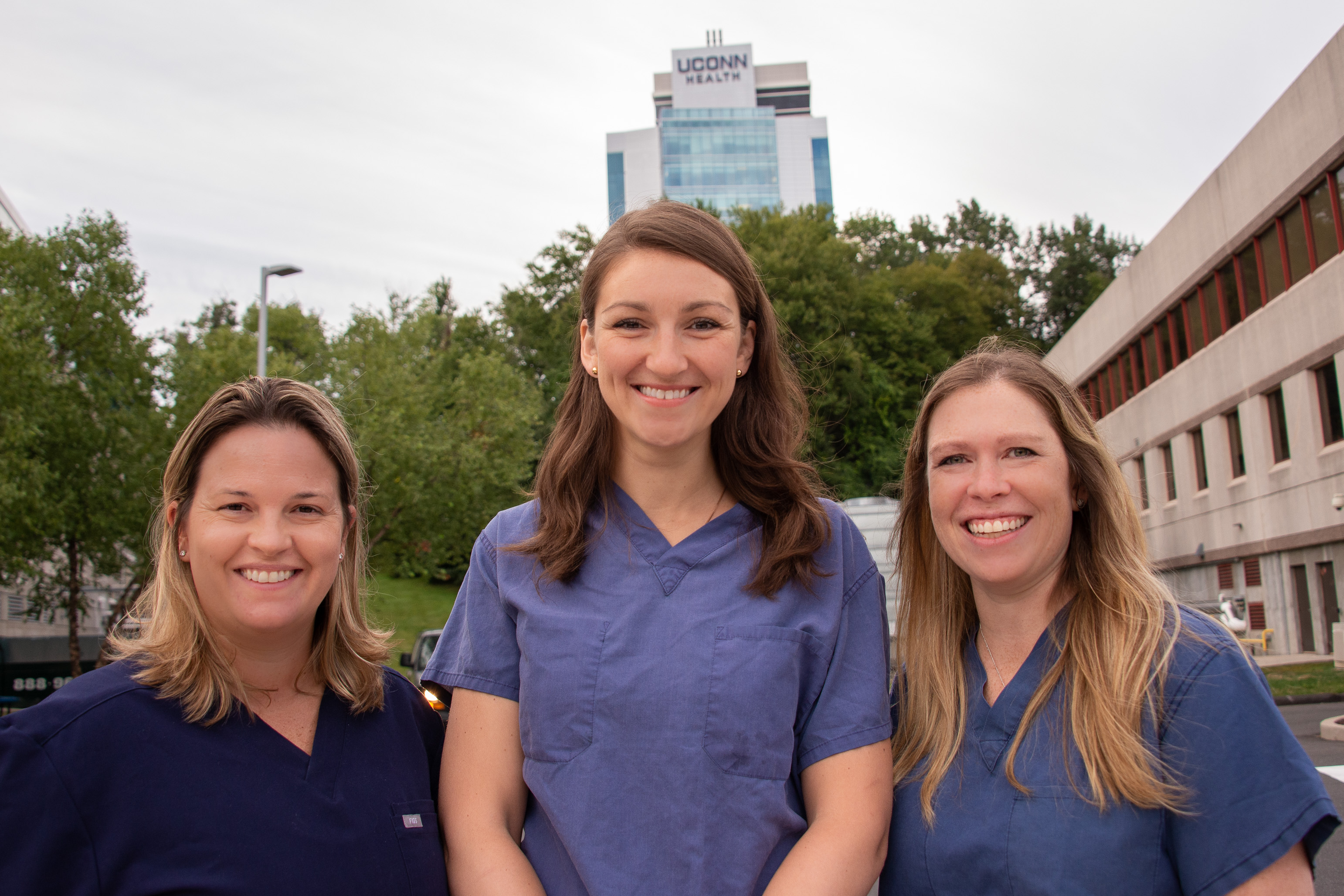 Drs. Kathy Coyner, Olga Solovyova, Lauren Geaney outside UConn Musculoskeletal Institute with University Tower in background
