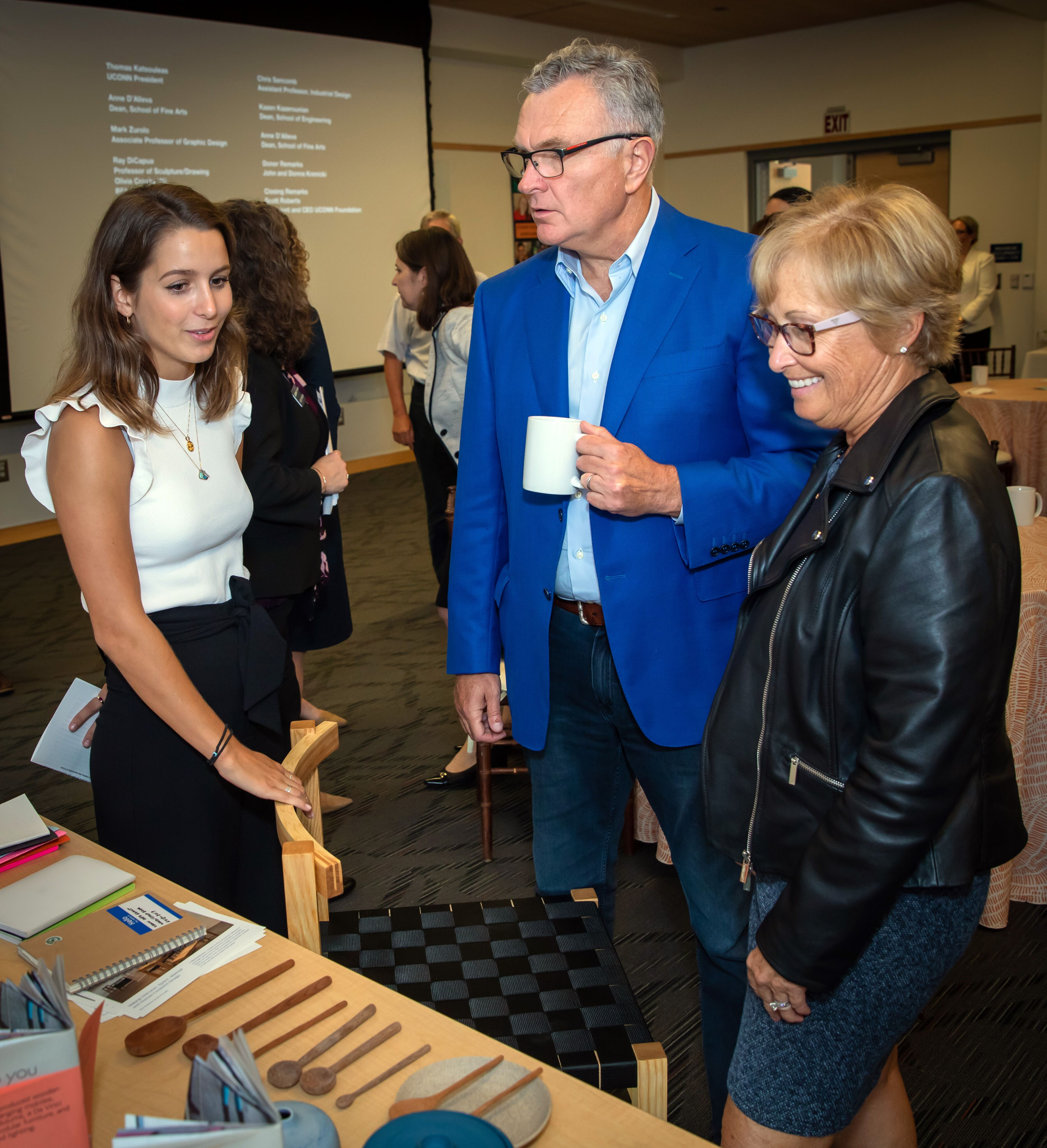 Following the announcement of their gift, John and Donna Krenicki hear from a student working at the intersection of the arts and engineering. (Gerry McCarthy/UConn Photo)