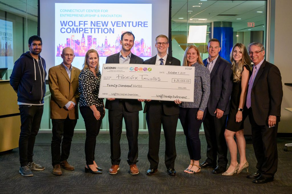 Phoenix Tailings, the group that won the 2019 Wolff New Venture Competition, poses for group photos with the judges.