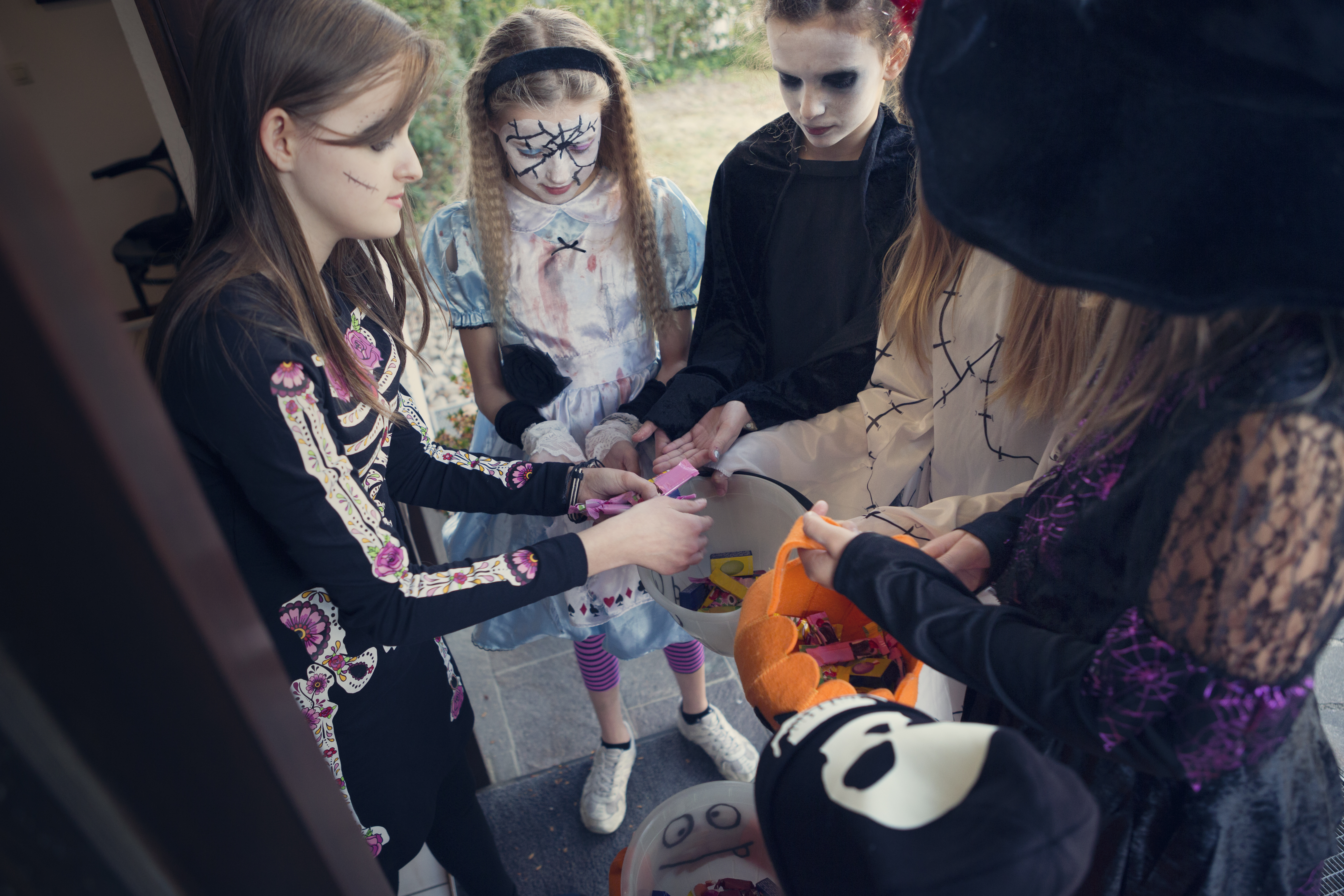 Group of girls trick or treating on Halloween
