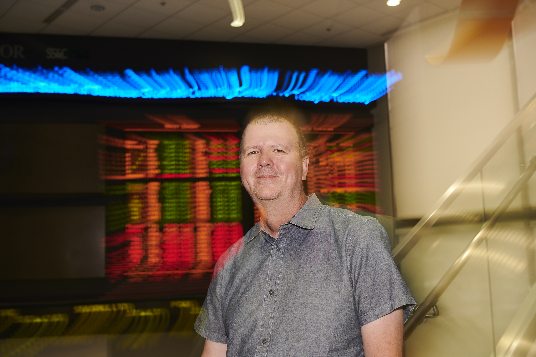 Paul Gilson, director and assistant professor of in residence of finance at the Graduate Business Learning Center in Hartford on Aug. 13, 2019. (Peter Morenus/UConn Photo)