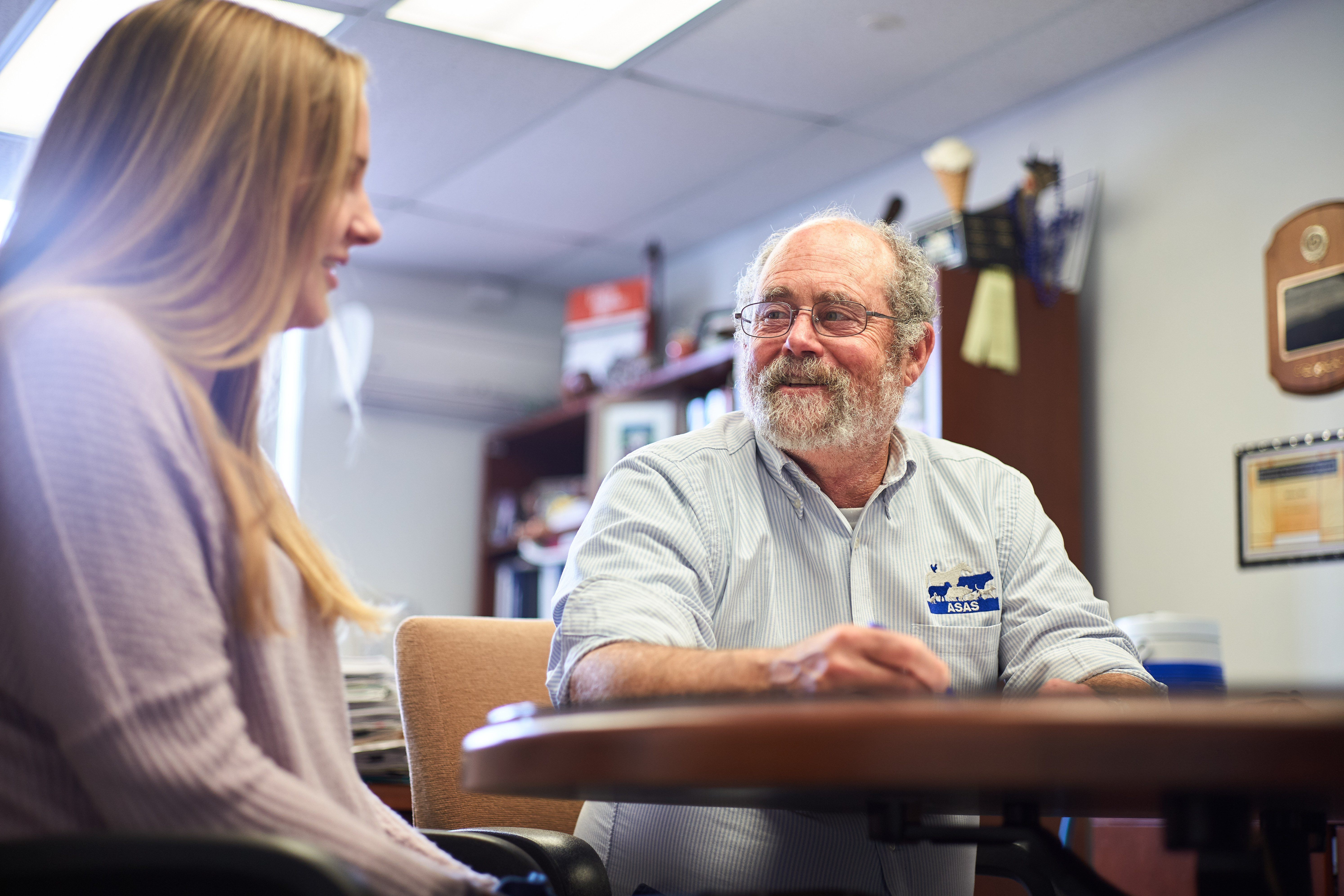 Steven Zinn, professor and head of animal scicence, in an advising session with C.J. Mozeika '20 (CAHNR) at his office in the George C. White Building on Oct. 16, 2019. (Peter Morenus/UConn Photo)