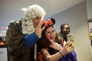 President Tom Katsouleas, wearing an Issac Newton costume participates in Halloween trick or treating at the Student Union on Oct. 31, 2019. (Peter Morenus/UConn Photo)