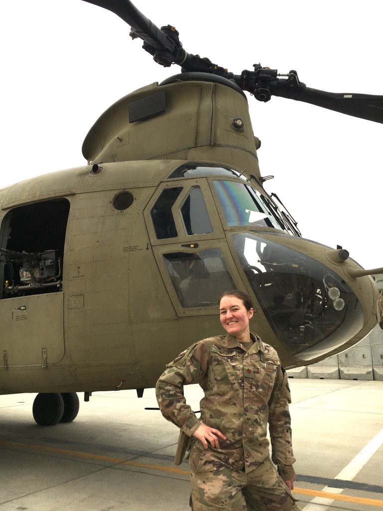 Sarah Kelly in front of a helicopter