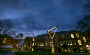 The sculpture in front of the Castleman Building at dusk