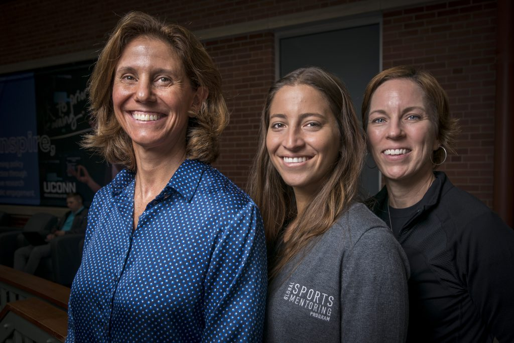 From left professor Laura Burton, Karen Chammas, visiting UConn's Sport Management faculty as part of a Global Mentorship Program, and Professor and Department Head Jennifer McGarry at the Neag School of Education on Oct. 31, 2019. (Sean Flynn/UConn Photo)