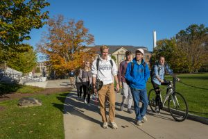 A group of students walk across the quad in front of the Student Union