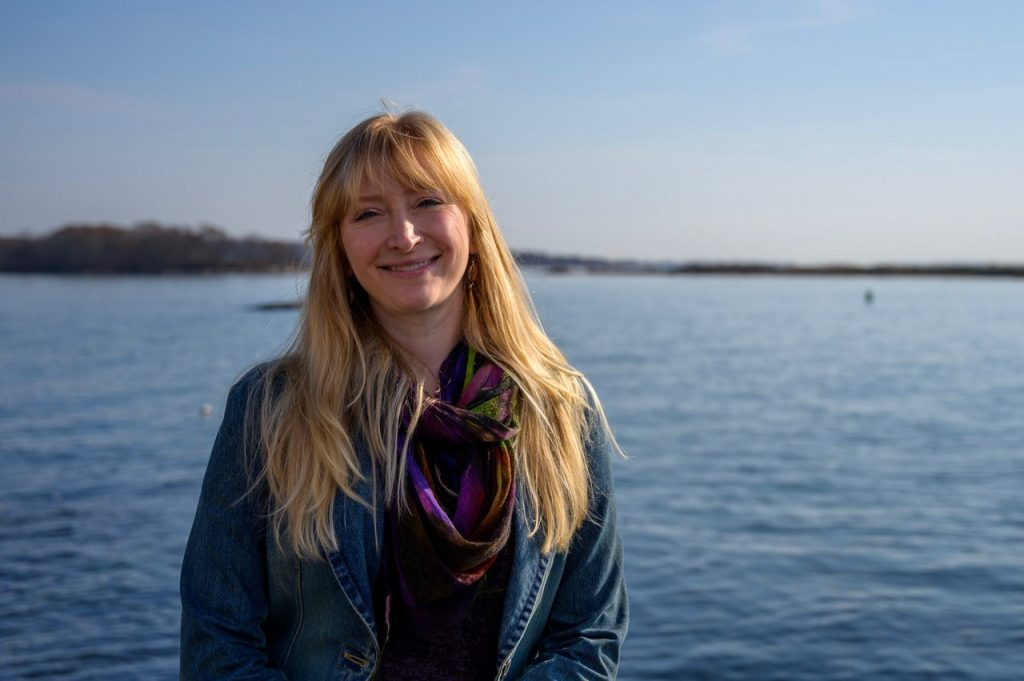 A picture of Samantha Siedlecki on the water at Long Island Sound.