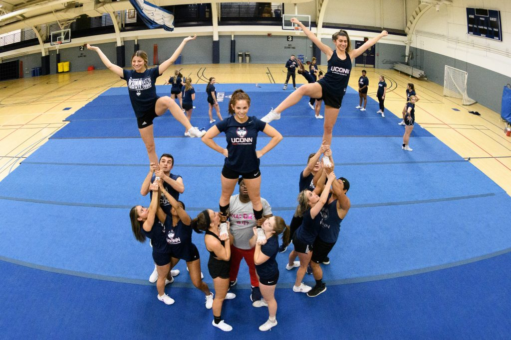 Cheerleaders practicing a routine.