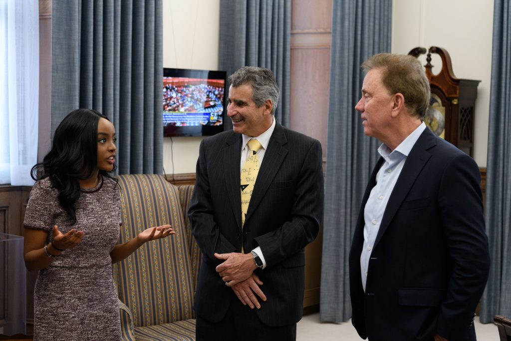 UConn Rhodes Scholar Wawa Gatheru talks with President Katsouleas and Governor Lamont at the State Capitol.