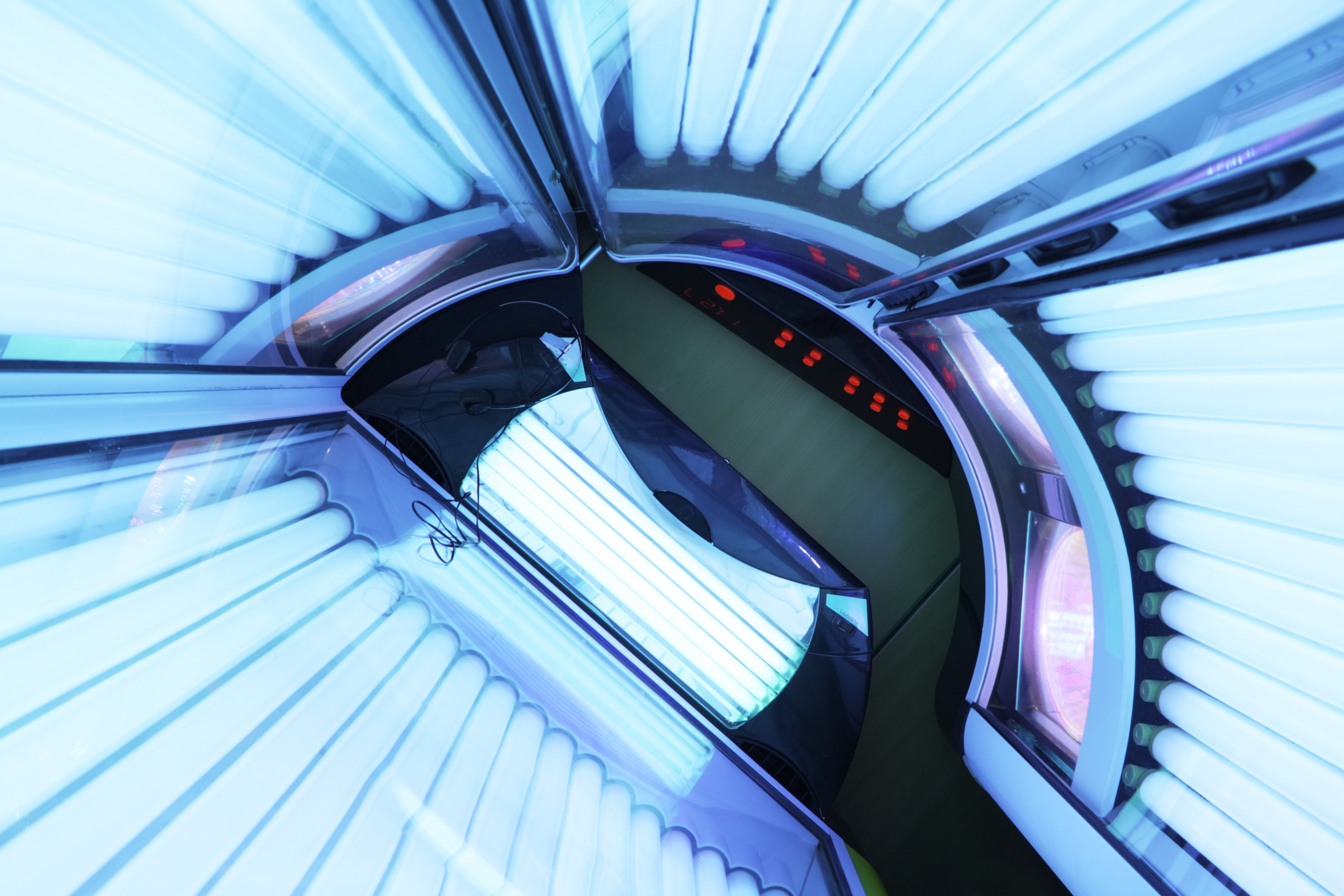 The inside of a tanning bed.