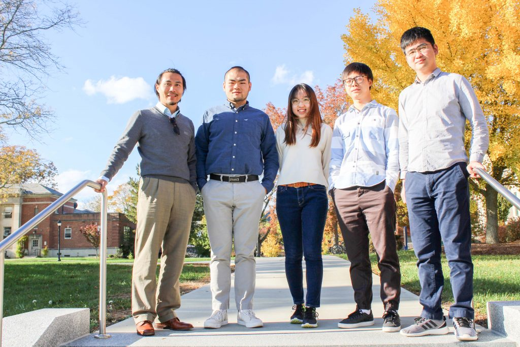 Zhe Zhu with graduate students from his lab outside in the fall.