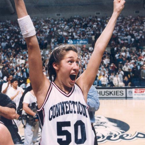 Rebecca Lobo with her arms raised.