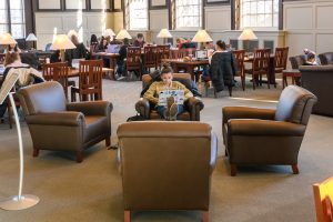 A student puts her feet up while studying at the Wilbur Cross South Reading Room.