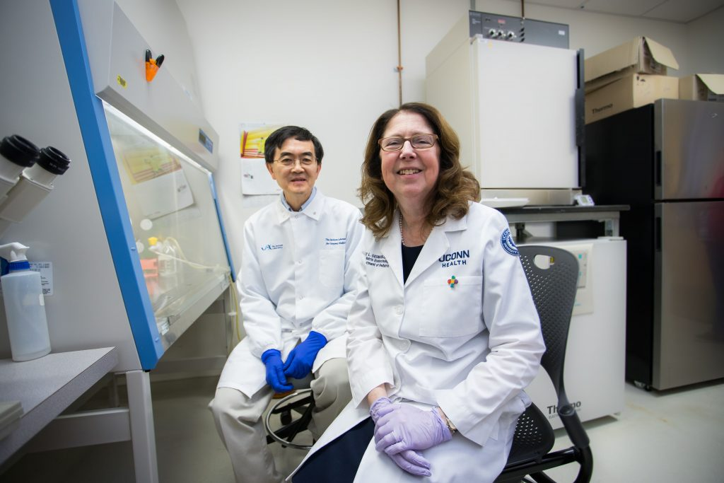 Researchers Se-Jin Lee and Emily Germain-Lee pose together in their lab.