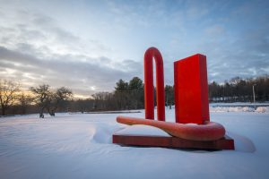The first step in the sculpture's journey was being removed from its old location (Sean Flynn/UConn Photo)