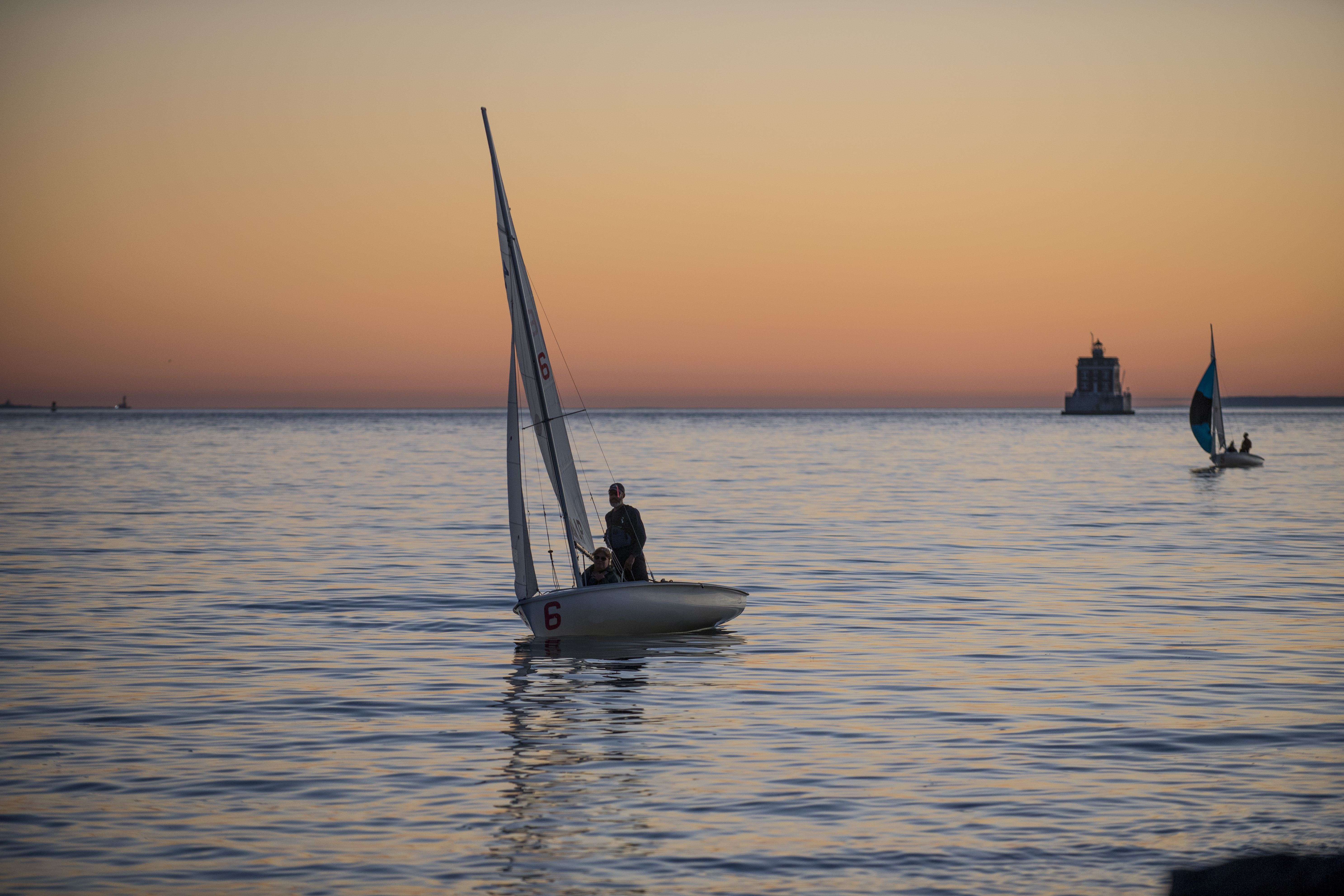 A sailboat in Long Island Sound at sunset